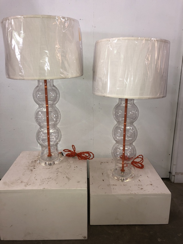 Glass bulbous lamps with orange accents
